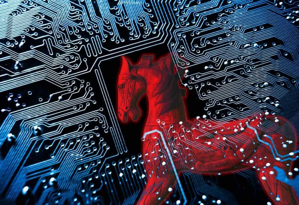 Cavalo de Tróia/símbolo de um cavalo de Tróia vermelho no fundo da placa de circuito do computador azul fazendo alusão aos malwares lançados por dia durante o ano de 2020